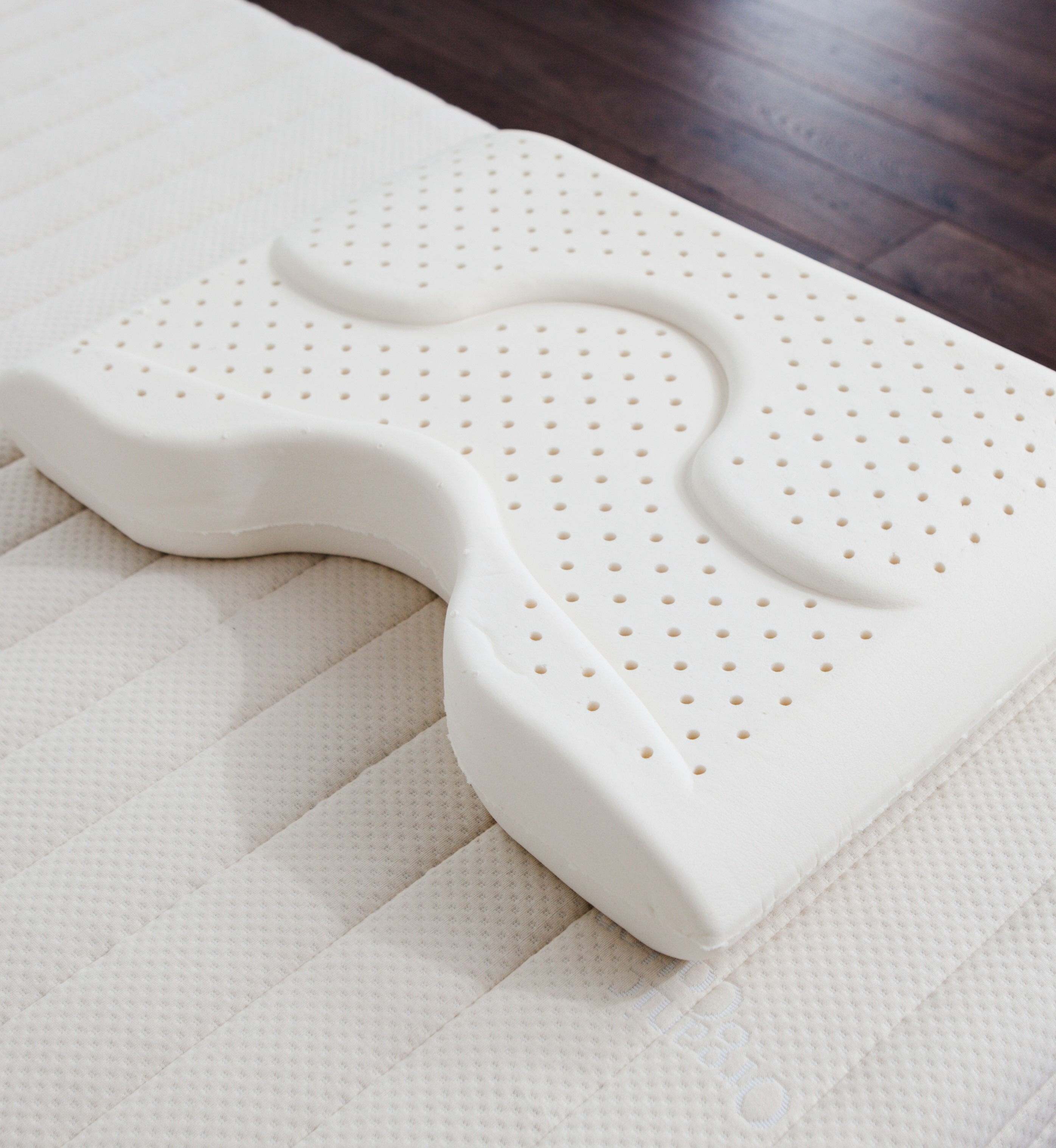 The Dream Pillow On Mattress with no cover with wood floor background